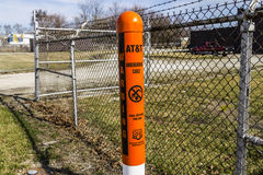 Indianapolis - Circa February 2017: AT&T Warning Post marking underground cables and a note to call 811 before digging I Royalty Free Stock Photos