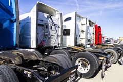 Indianapolis - Circa February 2017: Colorful Semi Tractor Trailer Trucks Lined up for Sale IV Stock Photos
