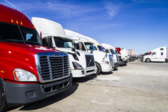 Indianapolis - Circa February 2017: Colorful Semi Tractor Trailer Trucks Lined up for Sale V Royalty Free Stock Image