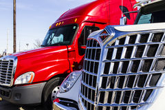Indianapolis - Circa February 2017: Navistar International and Freightliner Semi Tractor Trailer Trucks Lined up for Sale III Royalty Free Stock Images