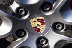 Indianapolis - Circa February 2017: Traditional Porsche Wheel Logo on a new 911. Porsche Racing Dates to the 1950s IV Stock Photo