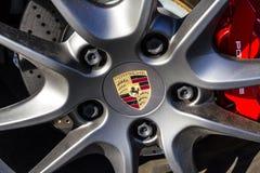 Indianapolis - Circa February 2017: Traditional Porsche Wheel Logo on a new 911. Porsche Racing Dates to the 1950s V Stock Photo