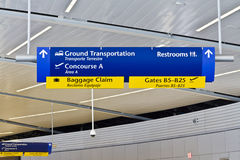 Indianapolis - Circa July 2016: Generic Direction Sign Assisting Travelers in the Airport I Stock Images