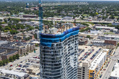 Indianapolis - Circa June 2017: Modern mixed use residential business apartment block skyscraper under construction I Royalty Free Stock Photography