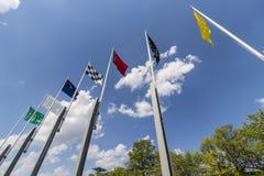 Indianapolis - Circa Maj 2017: De sju springa flaggorna på Indianapolis Motor Speedway IMS förbereder för Indyen 500 V Arkivbild