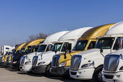 Indianapolis - Circa November 2016: Colorful Semi Tractor Trailer Trucks Lined up for Sale II Royalty Free Stock Images
