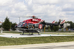 Indianapolis - Circa September 2016: Indiana University Health Lifeline Helicopter Prepares for Departure from IU Hospital North I. Indiana University Health Stock Images