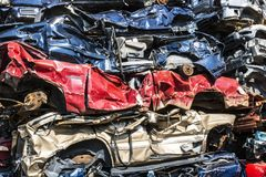 Indianapolis - Circa September 2017: Stacked junk yard clunker cars prepared for crushing to be recycled IX. Stacked junk yard clunker cars prepared for crushing Stock Photography