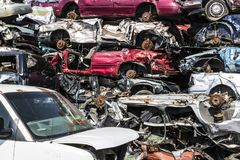 Indianapolis - Circa September 2017: Stacked junk yard clunker cars prepared for crushing to be recycled X. Stacked junk yard clunker cars prepared for crushing Stock Photos