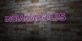 INDIANAPOLIS - Glowing Neon Sign on stonework wall - 3D rendered royalty free stock illustration Royalty Free Stock Image