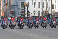 Indianapolis Metropolitan Police Motorcycle Drill Team at St Patrick's day Parade. In Indianapolis,IN royalty free stock photography