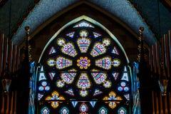Indianapolis: Około Marzec 2018: Róży okno przy Świętym Kierowym kościół katolickim Ten parafia ustanawiał w 1875 IV zdjęcie royalty free
