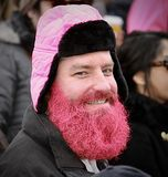 Pink bearded man supports women`s rally royalty free stock image