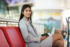 Indianbusinesswoman waiting flight Royalty Free Stock Images