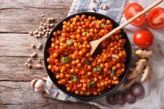 Indianina Chana masala z składnikami horyzontalny odgórny widok Zdjęcia Stock