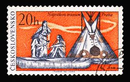 Indians, canoe and tepee, Indians of North America serie, circa. MOSCOW, RUSSIA - AUGUST 18, 2018: A stamp printed in Czechoslovakia shows Indians, canoe and royalty free stock photography