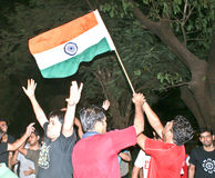Indians celebrating cricket match victory. Young men celebrating India's victory in Cricket World Cup Final organized by ICC recently in India on 02nd April Stock Photo