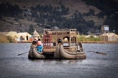 Indians sail by the boat. Royalty Free Stock Images