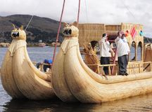 Indians sail by the handmade boat. Royalty Free Stock Images
