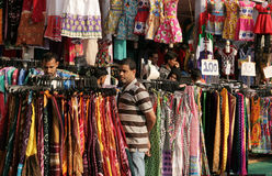 Indians shopping in road side clothes shop Royalty Free Stock Image