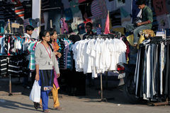 Indians shopping in road side clothes shop Royalty Free Stock Photos