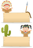Indians and Wooden Board. Two cartoon american indian or native kids (boy and girl) with blank wooden banner, isolated on white background. Eps file available Royalty Free Stock Photos
