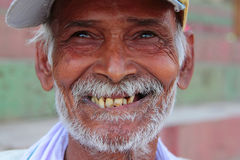 IndianSmile. A man smiles as he talks to me about his life in India Stock Image