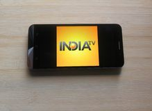 IndiaTV News app. On smartphone kept on wooden table stock photography
