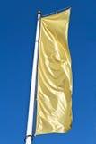 Indicador de oro de la bandera vertical vacía Imagen de archivo
