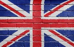 Indicador del Reino Unido en la pared de ladrillo Imágenes de archivo libres de regalías