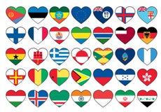 Banderas del corazón fijadas Imagen de archivo
