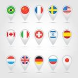 Indicadores del mapa con las banderas Fotografía de archivo