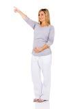Indicare della donna incinta Fotografie Stock