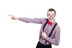 Indicare emozionante dell'uomo del nerd Fotografia Stock