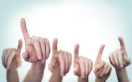 Indicare le mani su fondo Immagini Stock