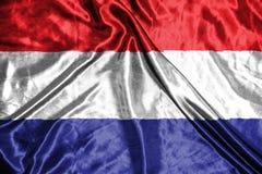 Indicateur de Netherland drapeau sur le fond Image stock