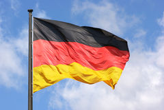 Drapeau et ciel allemands Photos stock