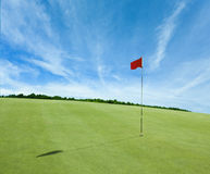 Indicateur rouge et la zone de golf Images libres de droits