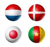 Indicateurs du groupe E de coupe du monde du football sur des billes de football Images libres de droits