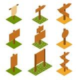 Indicateurs en bois isométriques sur l'herbe Image stock