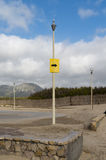 Indication of direction on a pole in an empty parking lot near a beach. Yellow indication of direction on a pole in an empty parking lot near a beach Royalty Free Stock Image