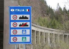 Indications of the speed limits to be observed on the Italian ro. Road sign at the Italian border with indications of the speed limits to be observed on the stock images
