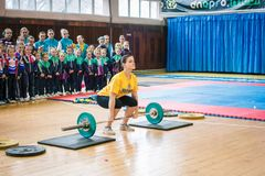 Indicative performance of weightlifters at the championship in cheerleading,young girl lifts a heavy barbell, barbell weight - 35k stock image