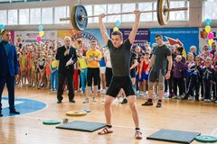 Indicative performance of weightlifters at the championship in cheerleading, young man lifts a heavy barbell, barbell weight - 80 royalty free stock photo