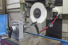 Indicator gauge Rotary punch former on Grinding machine Stock Photo