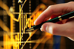 Indicatore della penna e della mano, diagramma Immagine Stock