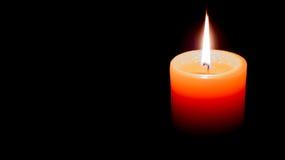 Indicatore luminoso della candela nello scuro Fotografia Stock Libera da Diritti