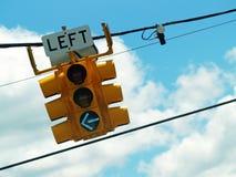 Indicatore luminoso di girata di sinistra Fotografie Stock Libere da Diritti