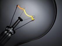 Indicatore luminoso di lampadina sopra grey Fotografie Stock Libere da Diritti