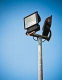 Indicatore luminoso e cielo blu di sport Fotografie Stock Libere da Diritti